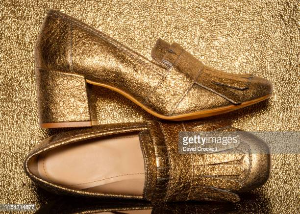 gold high heel shoes - gold shoe stock pictures, royalty-free photos & images