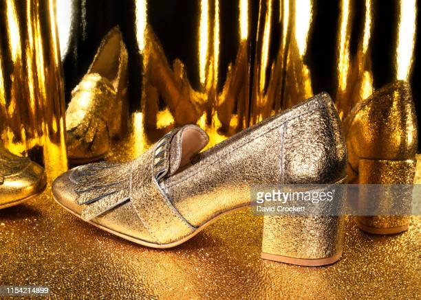 gold high heel shoes - gold shoe stock photos and pictures