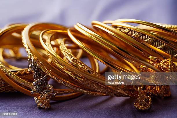 gold Indian bangles on purple sari cloth