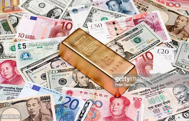 Gold ingot and bank notes