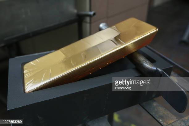 Gold ingot cools in its mold at the Uralelectromed Copper Refinery, operated by Ural Mining and Metallurgical Co. , in Verkhnyaya Pyshma, Russia, on...