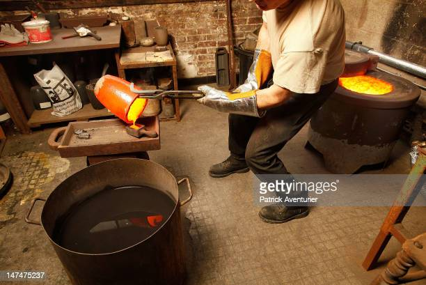 A gold ingot is formed from jewelry purchased by the company 'Gold By Gold' melted at greater than 1000 degrees fahrenheit to be transformed into...