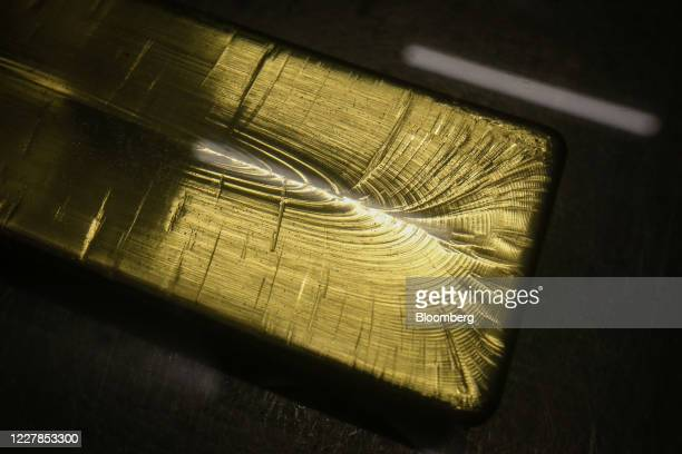 Gold ingot sits following cooling at the Uralelectromed Copper Refinery, operated by Ural Mining and Metallurgical Co. , in Verkhnyaya Pyshma,...