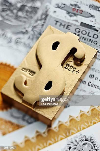 Gold ingot with dollar sign symbol