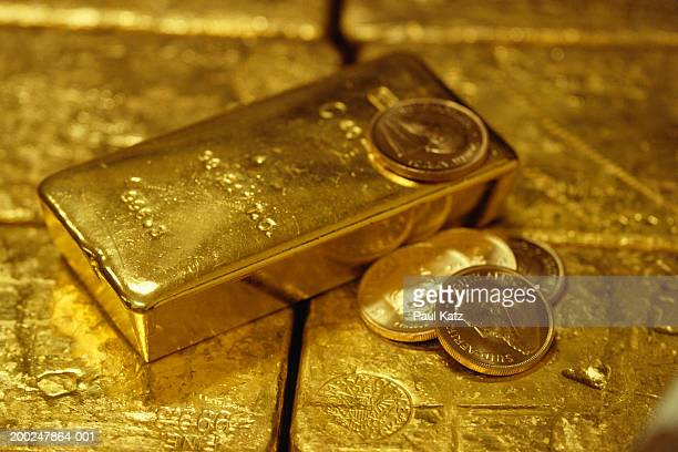 Gold ingots and gold coins, (Close-up)