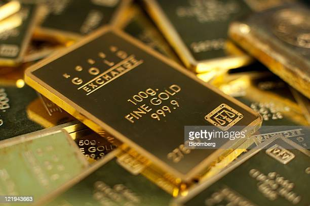 Gold ingots are arranged for a photograph at the Korea Gold Exchange headquarters in Seoul South Korea on Wednesday Aug 24 2011 Gold rebounded after...
