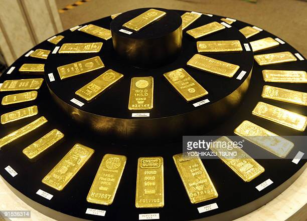 Gold ingots from various countries are displayed at the Ginza Tanaka gold jewelery shop in preparation for the Tokyo Gold Week exhibition in Tokyo on...