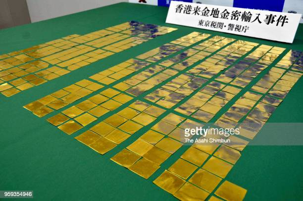 Gold ingots which was seized in December at Narita Airport in a smuggling attempt is displayed at Tokyo Customs on May 16 2018 in Tokyo Japan Police...