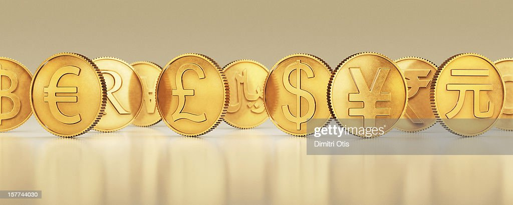 Gold international currency coins in a line : Stock Photo