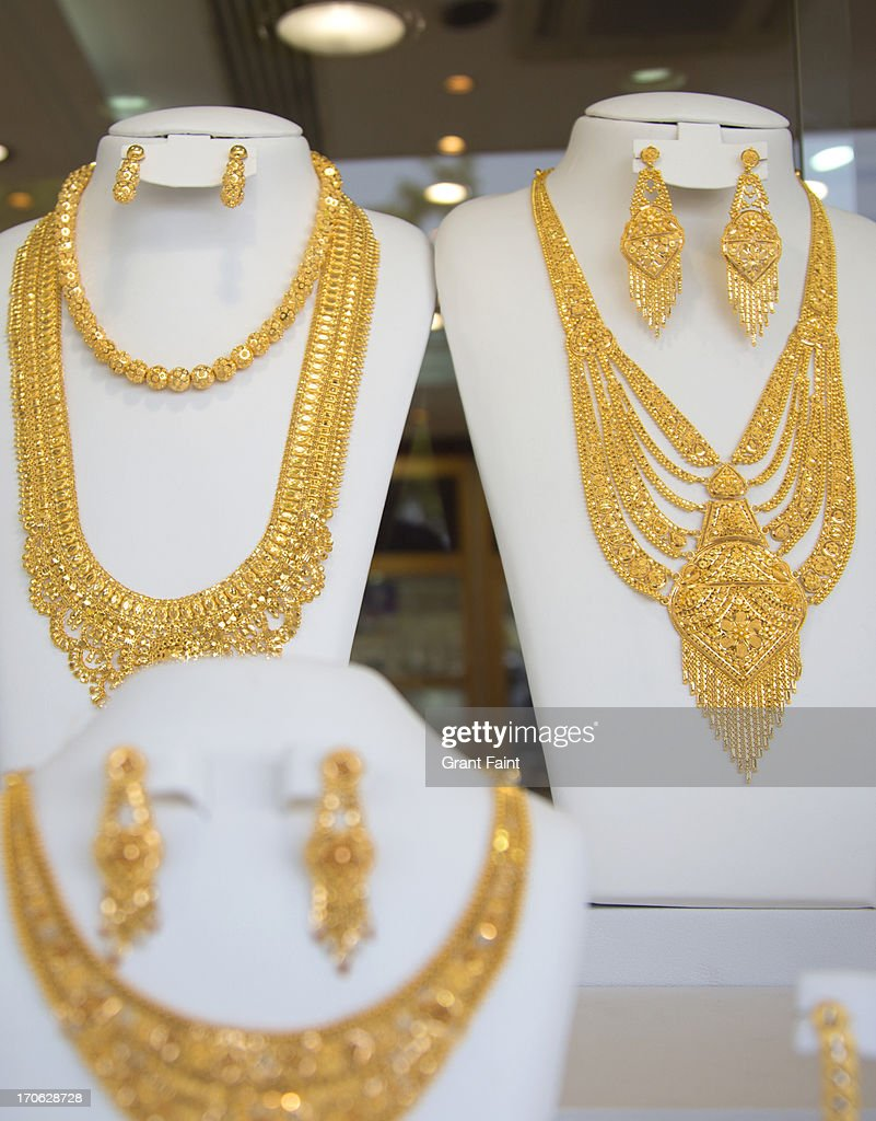Gold Jewellery For Sale In Window Shop Stock Photo | Getty Images