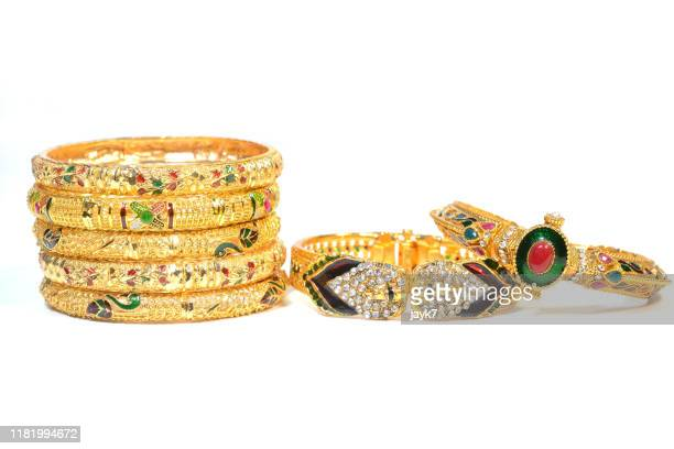 gold jewellery - bangle stock pictures, royalty-free photos & images