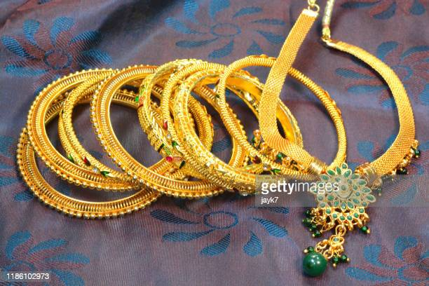 gold jewellery - jewelry stock pictures, royalty-free photos & images