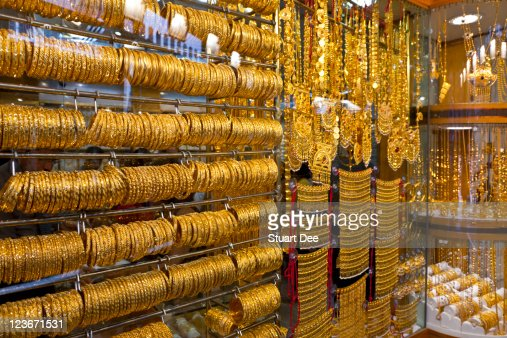 Gold jewelry for sale gold souk dubai stock photo getty for Jewelry sale online shopping