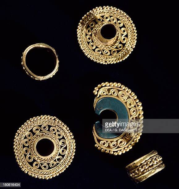 Gold jewelry originating from Ecuador a nose ring a brooch and various ornaments for the ears PreColombian Civilization
