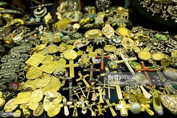 Gold jewelry religious icons and cross in The Grand Bazaar Kapalicarsi great market in Beyazi Istanbul Turkey