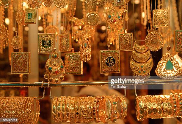 Gold jewels - necklaces, bangles, bracelets and pendants on display at the Gold Souk in Kuwait City, Kuwait.