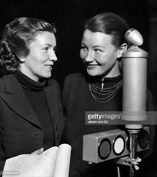Gold Kaethe Actress Austria*mit Doris Krueger standing behind a microphone Photographer Ullmann Published by 'Sieben Tage' 5/1939Vintage property of...