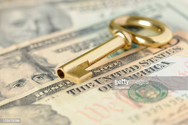 gold key to success over united states dollars in cash - monetary policy stock pictures, royalty-free photos & images