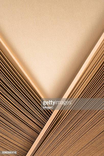 gold kraft paper stripes v shape - champagne coloured stock photos and pictures