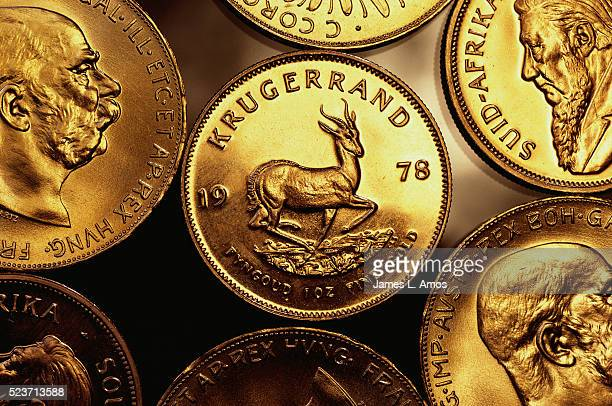 gold krugerrand coins - south african currency stock pictures, royalty-free photos & images
