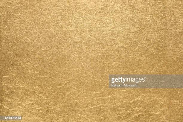 gold leaf texture background - gold foil stock photos and pictures