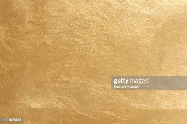 gold leaf texture background - brass stock pictures, royalty-free photos & images
