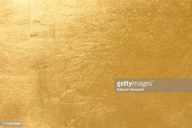 gold leaf texture background - gold colored stock pictures, royalty-free photos & images