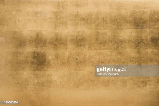 gold leaf wall texture background - gilded stock pictures, royalty-free photos & images