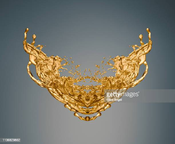 gold liquid pattern - splashing stock pictures, royalty-free photos & images