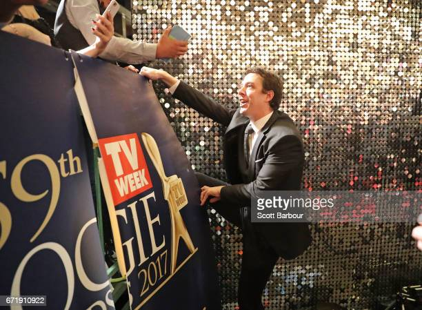 Gold Logie nominee Samuel Johnson climbs into the crowd to meet fans at the 59th Annual Logie Awards at Crown Palladium on April 23 2017 in Melbourne...