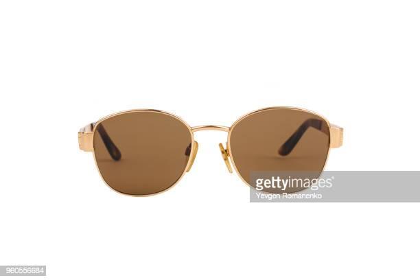 gold luxury sunglasses isolated on white background - sonnenbrille stock-fotos und bilder