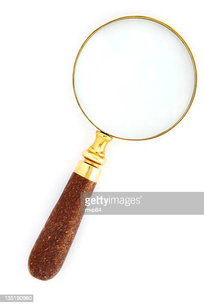 Gold magnifying glass with a wooden handle