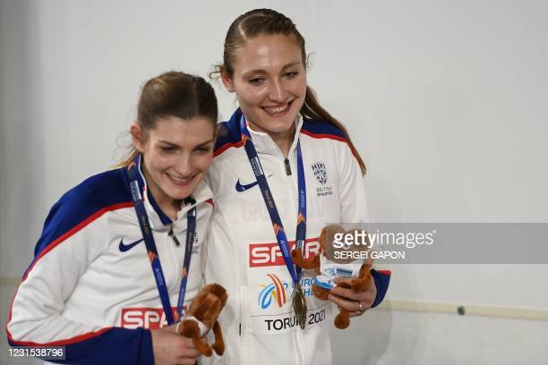 Gold meadlist Britain's Amy-Eloise Markovc and bronze medalist Britain's Verity Ockenden celebrate after the medal ceremony for the women's 3000m at...