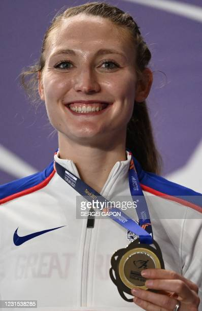 Gold meadlist Britain's Amy-Eloise Markovc celebrates on the podium during the medal ceremony for the women's 3000m at the 2021 European Athletics...