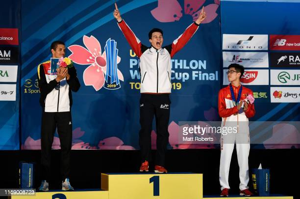 Gold mealist Joseph Choong of Great Britain celebrates on the podium during the men's medal ceremony on day three of the UIPM World Cup, Modern...