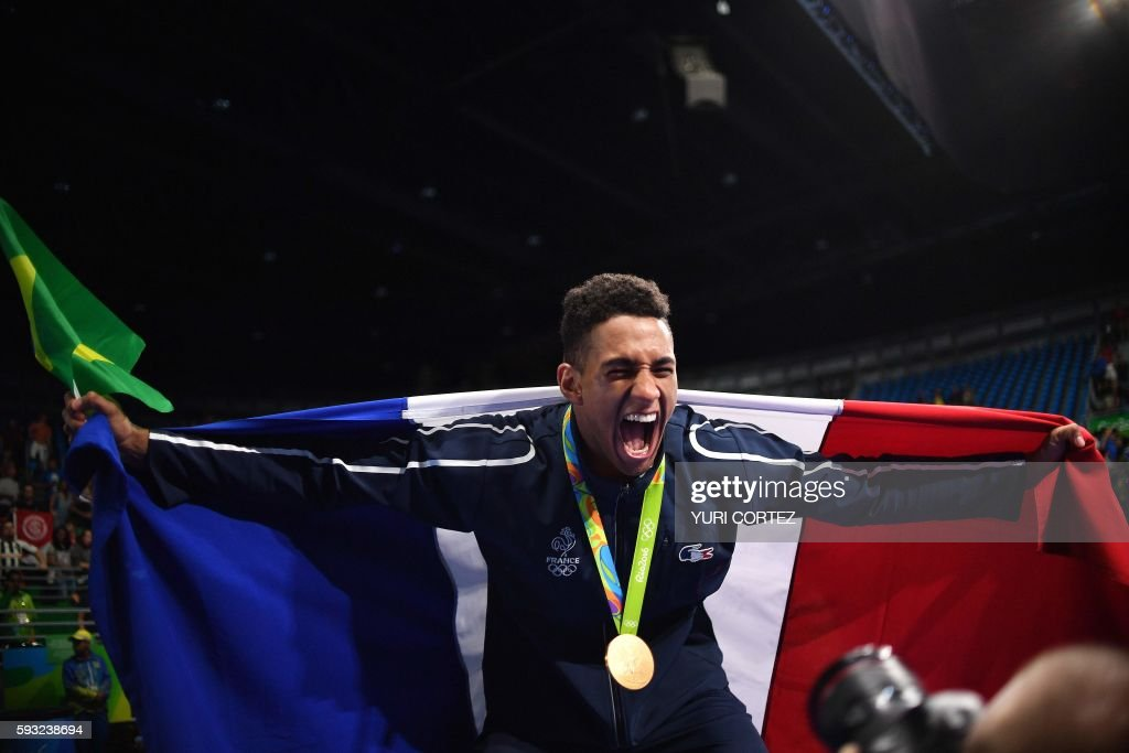 TOPSHOT - Gold medailst France's Tony Victor James Yoka reacts during the medal presentation ceremony following the Men's Super Heavy (+91kg) Final Bout at the Rio 2016 Olympic Games at the Riocentro - Pavilion 6 in Rio de Janeiro on August 21, 2016. / AFP PHOTO / Yuri CORTEZ