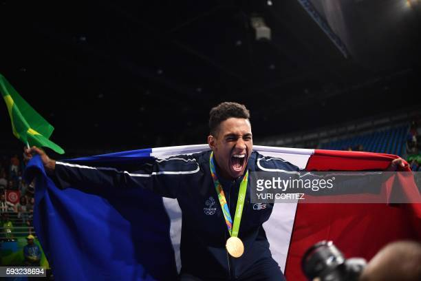 TOPSHOT Gold medailst France's Tony Victor James Yoka reacts during the medal presentation ceremony following the Men's Super Heavy Final Bout at the...