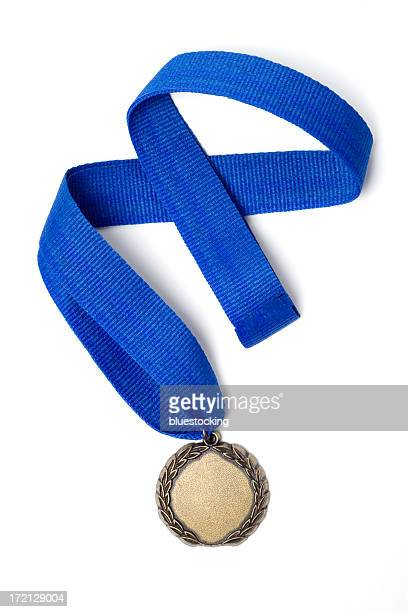 Gold medal award on a blue ribbon