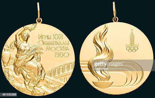 A gold medal featuring Victory seated above a stadium and on the reverse the Olympic flame and the Games logo beyond awarded to East German rower...