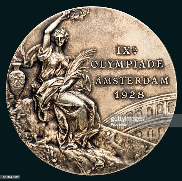 A gold medal from the 1928 Amsterdam Olympic Games awarded to the Swedish heavyweight GrecoRoman wrestler Rudolf Svensson featuring Victory holding a...