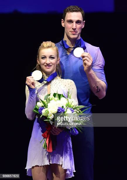 Gold medal Germany's Aljona Savchenko and Bruno Massot pose on the podium during the medal ceremony on March 22 2018 during the Pairs Free Skate at...