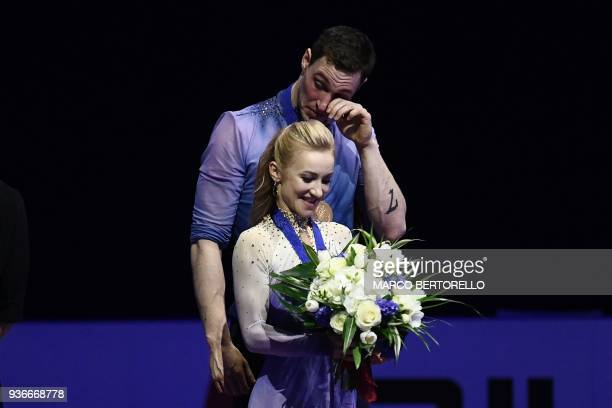 Gold medal Germany's Aljona Savchenko and Bruno Massot react on the podium during the medal ceremony on March 22 2018 during the Pairs Free Skate at...