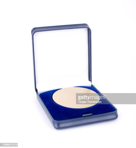 gold medal in a blue case isolated on white background - cérémonie de remise de prix photos et images de collection