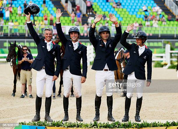 Gold medal medalist's Karim Laghouag, Thibaut Vallette, Mathieu Lemoine and Astier Nicolas of France pose during the medal ceremony for the eventing...