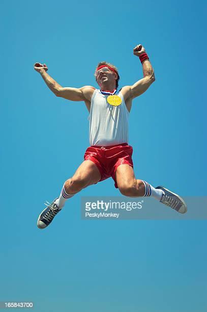 Gold Medal Nerd Athlete Jumps in Blue Sky