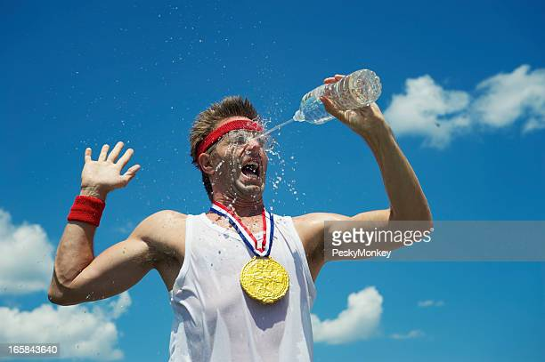 Gold Medal Nerd Athlete Splashes His Face with Water