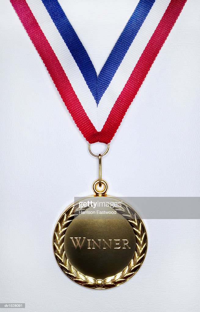 Gold Medal on a White Background Engraved With the Single Word Winner : Stock Photo
