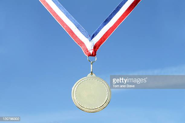 Gold medal on blue sky