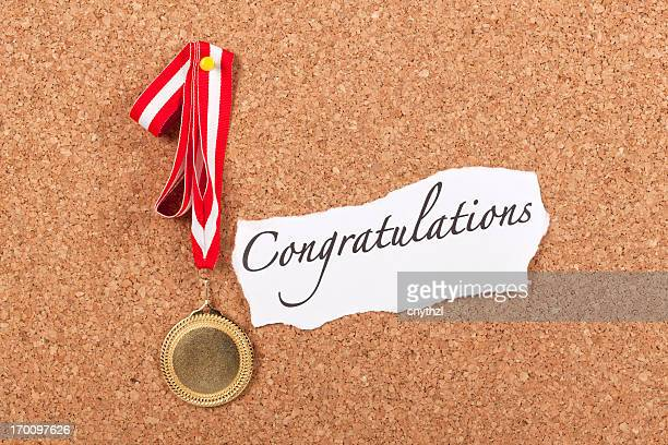 Gold Medal on Corkboard with Congratulations Message