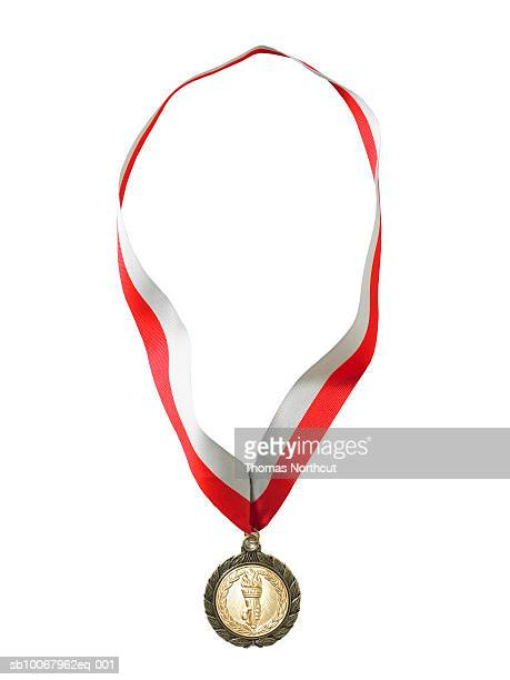 Gold medal on white background